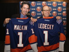 UNIONDALE, NY - OCTOBER 22:  New York Islanders partners Scott Malkin (L) and Jon Ledecky (R) pose for a photo opportunity during a press conference at Nassau Coliseum on October 22, 2014 in Uniondale, New York.  (Photo by Bruce Bennett/Getty Images)