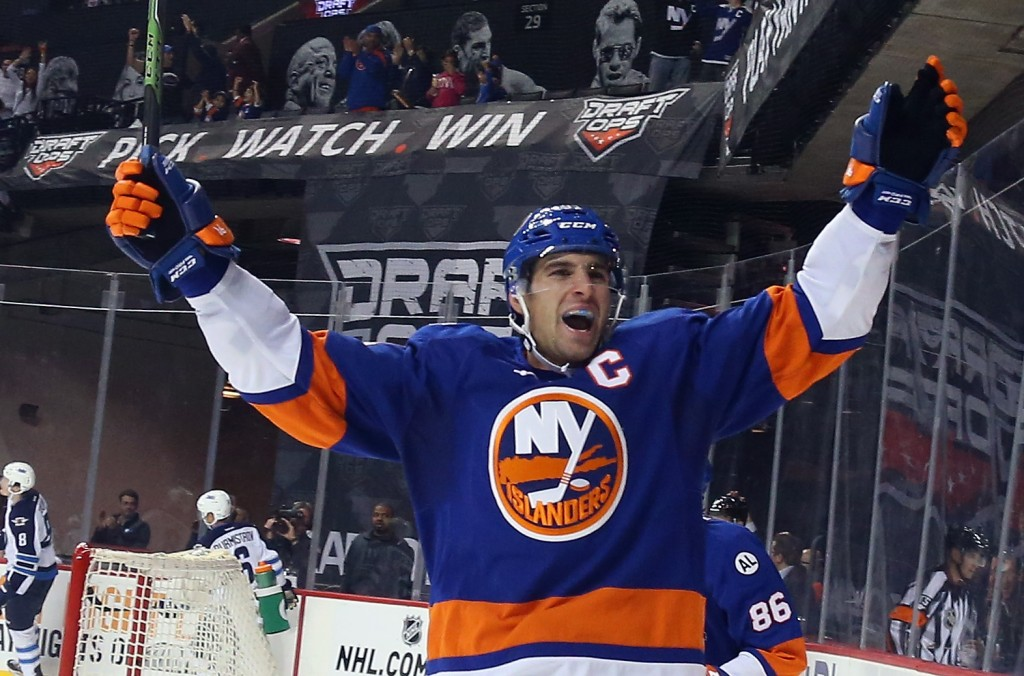 NEW YORK, NY - OCTOBER 12:  John Tavares #91 of the New York Islanders celebrates a second period goal by Brock Nelson #29 against the Winnipeg Jets at the Barclays Center on October 12, 2015 in the Brooklyn borough of New York City.</p /> </p><!-- google_ad_section_end --></div>     <div class=
