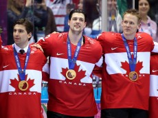 SOCHI, RUSSIA - FEBRUARY 23:  Gold medalists John Tavares #20, Jamie Benn #22 and Corey Perry #24 of Canada celebrate during the medal ceremony after defeating Sweden 3-0 during the Men's Ice Hockey Gold Medal match on Day 16 of the 2014 Sochi Winter Olympics at Bolshoy Ice Dome on February 23, 2014 in Sochi, Russia.  (Photo by Bruce Bennett/Getty Images)