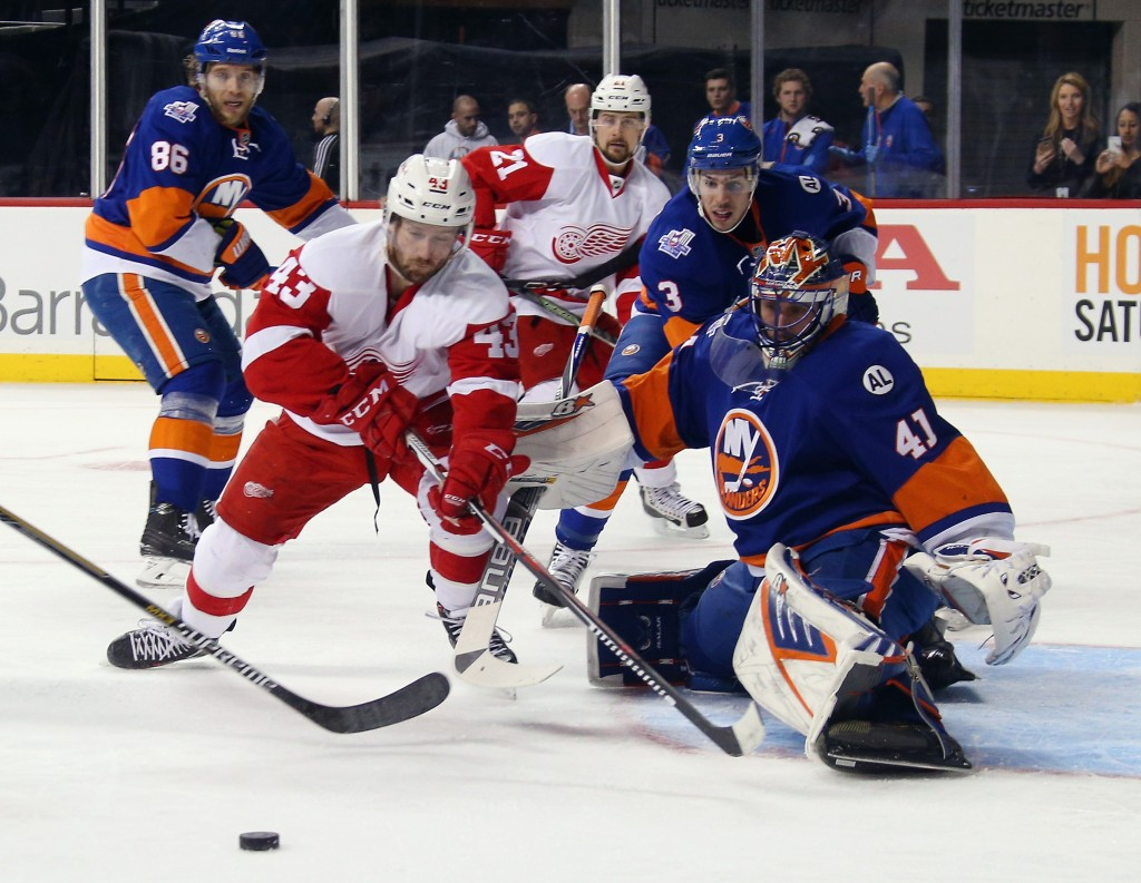 NEW YORK, NY - JANUARY 25:  Darren Helm #43 of the Detroit Red Wings misses a first period attempt against Jaroslav Halak #41 of the New York Islanders at the Barclays Center on January 25, 2016 in the Brooklyn borough of New York City.  (Photo by Bruce Bennett/Getty Images)