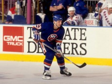 NEW YORK, NY - 1995:  Benoit Hogue #33 of the New York Islanders skates on the ice during an NHL game against the New York Rangers circa 1995 at the Madison Square Garden in New York, New York.  (Photo by B Bennett/Getty Images)