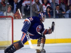 LANDOVER, MD - APRIL, 1985:  Goalie Kelly Hrudey #30 of the New York Islanders makes the glove save during the 1985 Eastern Division Semi Finals against the Washington Capitals in April, 1985 at the Capital Centre in Landover, Maryland.  (Photo by B Bennett/Getty Images)