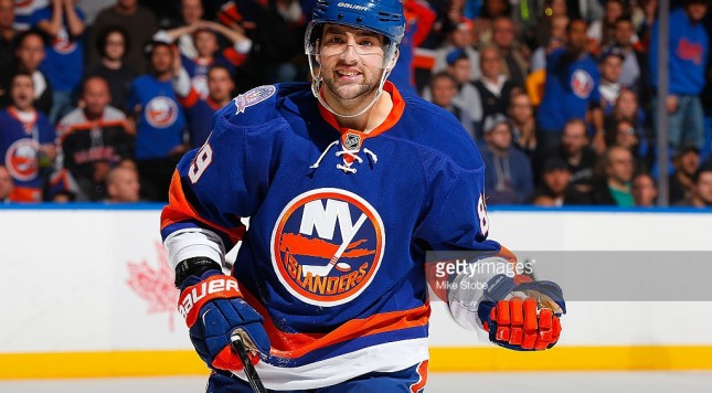 Cory-conacher-of-the-new-york-islanders-skates-against-the-winnipeg-picture-id458905620-645x356