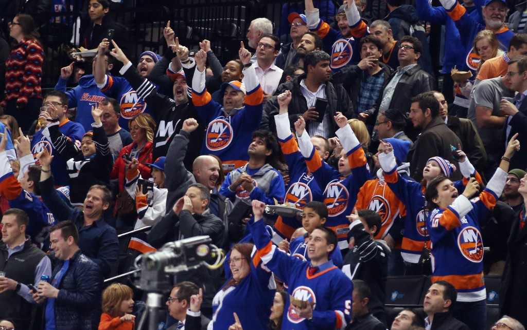 NEW YORK, NY - FEBRUARY 02: The New York Islanders fans celebrate a goal by Anders Lee #27 against the Minnesota Wild at the Barclays Center on February 2, 2016 in the Brooklyn borough of New York City.  (Photo by Bruce Bennett/Getty Images)