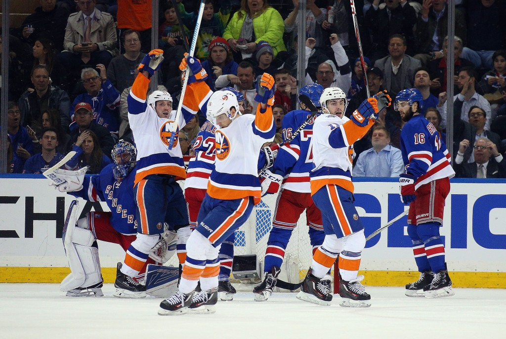 NEW YORK, NY - APRIL 07:  Shane Prince #11 of the New York Islanders (r) celebrates his goal at 13:28 of the second period against the New York Rangers at Madison Square Garden on April 7, 2016 in New York City. The Islanders defeated the Rangers 4-1.  (Photo by Bruce Bennett/Getty Images)