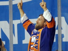 "NEW YORK, NY - OCTOBER 16:  Daniel Bryan of the WWE leads the ""yes, yes, yes"" chants during the game between the New York Islanders and the Anaheim Ducks  at the Barclays Center on October 16, 2016 in the Brooklyn borough of New York City.  (Photo by Bruce Bennett/Getty Images)"