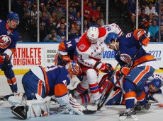 UNIONDALE, NY - APRIL 19: Jay Beagle #83 of the Washington Capitals looks for the rebound as the puck bounces off the leg pad of Jaroslav Halak #41 of the New York Islanders during the first period in Game Three of the Eastern Conference Quarterfinals during the 2015 NHL Stanley Cup Playoffs at the Nassau Veterans Memorial Coliseum on April 19, 2015 in Uniondale, New York.  (Photo by Bruce Bennett/Getty Images)