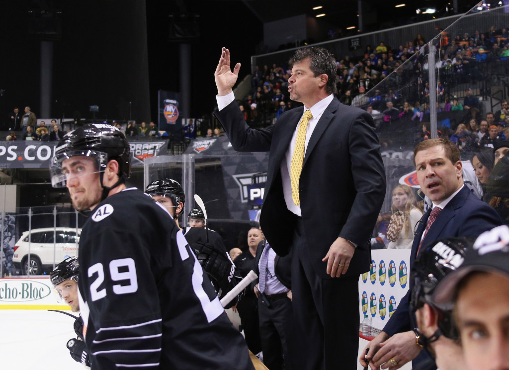 NEW YORK, NY - JANUARY 17: Jack Capuano of the New York Islanders signals the referee during the third period against the Vancouver Canucks at the Barclays Center on January 17, 2016 in the Brooklyn borough of New York City. The Canucks defeated the Islanders 2-1 in the shootout.</p /> </p><!-- google_ad_section_end --></div>     <div class=
