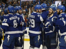 TAMPA, FL - MAY 8: Members of the Tampa Bay Lightning celebrate a series win over the New York Islanders after Game Five of the Eastern Conference Second Round during the 2016 NHL Stanley Cup Playoffs at Amalie Arena on May 8, 2016 in Tampa, Florida. (Photo by Mike Carlson/Getty Images)