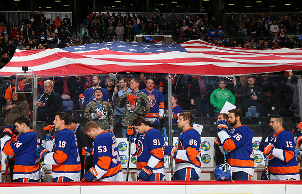 NEW YORK, NY - NOVEMBER 14:  The New York Islanders stands during the National Anthem prior to the game against the Tampa Bay Lightning at the Barclays Center on November 14, 2016 in Brooklyn borough of New York City.</p /> </p><!-- google_ad_section_end --></div>     <div class=