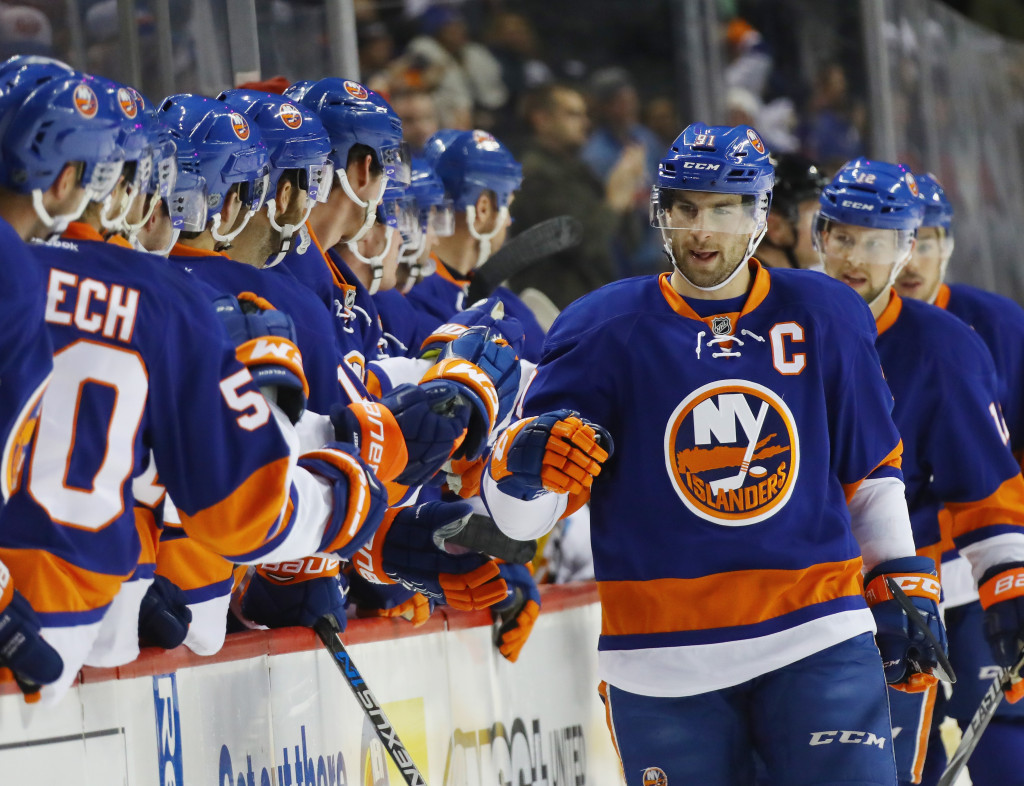 NEW YORK, NY - NOVEMBER 28: John Tavares #91 of the New York Islanders celebrates his goal at 7:28 of the first period against the Calgary Flames at the Barclays Center on November 28, 2016 in the Brooklyn borough of New York City.