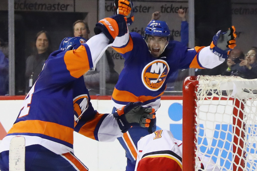 NEW YORK, NY - NOVEMBER 28: (L-R) Thomas Hickey #14 and Shane Prince #11 of the New York Islanders celebrate Hickey's game winning overtime goal against Brian Elliott #1 of the Calgary Flames at the Barclays Center on November 28, 2016 in the Brooklyn borough of New York City.</p /> </p><!-- google_ad_section_end --></div>     <div class=