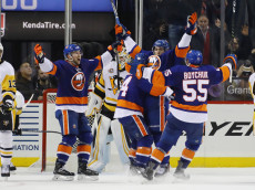 NEW YORK, NY - NOVEMBER 30: Anders Lee #27 of the New York Islanders celebrates his game winning goal at 19:33 of the third period against the Pittsburgh Penguins at the Barclays Center on November 30, 2016 in the Brooklyn borough of New York City. The Islanders defeated the Penguins 5-3. (Photo by Bruce Bennett/Getty Images)