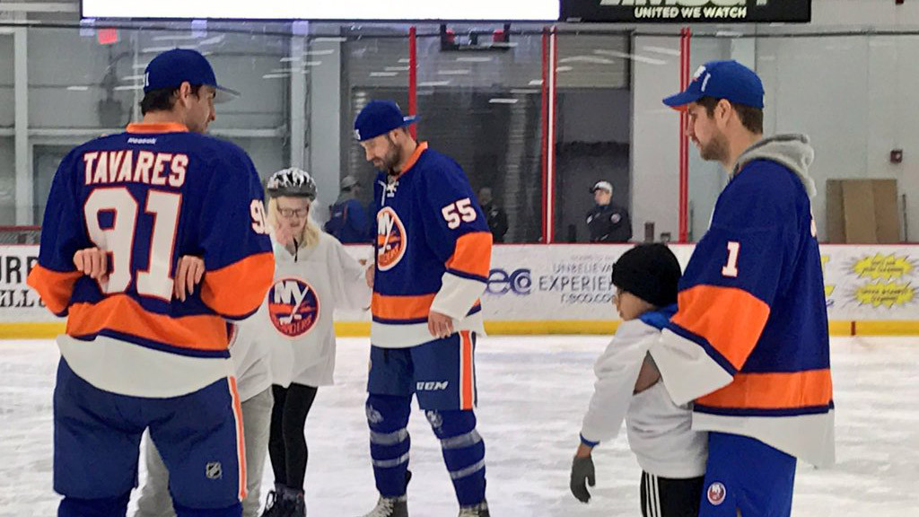 Islanders skate with visually impaired kids from the New York Institute of Special Education and Third Eye Insight.