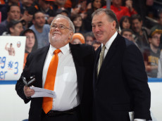 UNIONDALE, NY - NOVEMBER 19: (L-R) Jiggs McDonald and Ed Westfall watch a banner raising in honor of Ed Westfall prior to the game between the New York Islanders and the Boston Bruins at the Nassau Veterans Memorial Coliseum on November 19, 2011 in Uniondale, New York.  (Photo by Bruce Bennett/Getty Images)