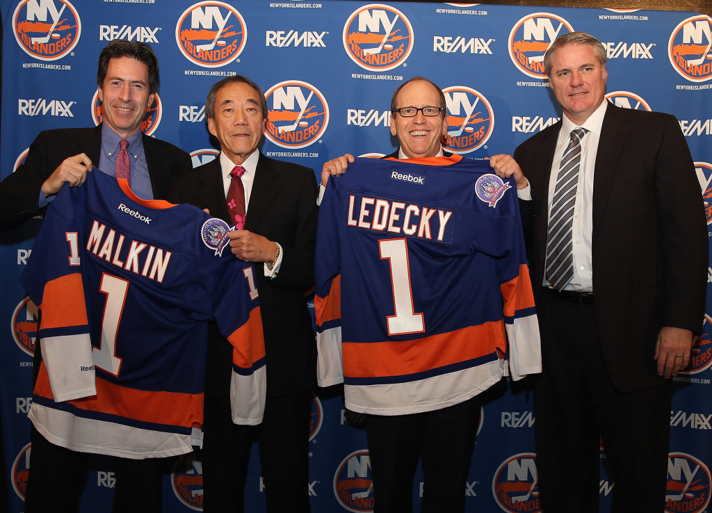 UNIONDALE, NY - OCTOBER 22: (l-r) New York Islanders partners Scott Malkin, Charles Wang and Jon Ledecky, along with general manager Garth Snow pose for a photo opportunity during a press conference at Nassau Coliseum on October 22, 2014 in Uniondale, New York.</p /> </p><!-- google_ad_section_end --></div>     <div class=