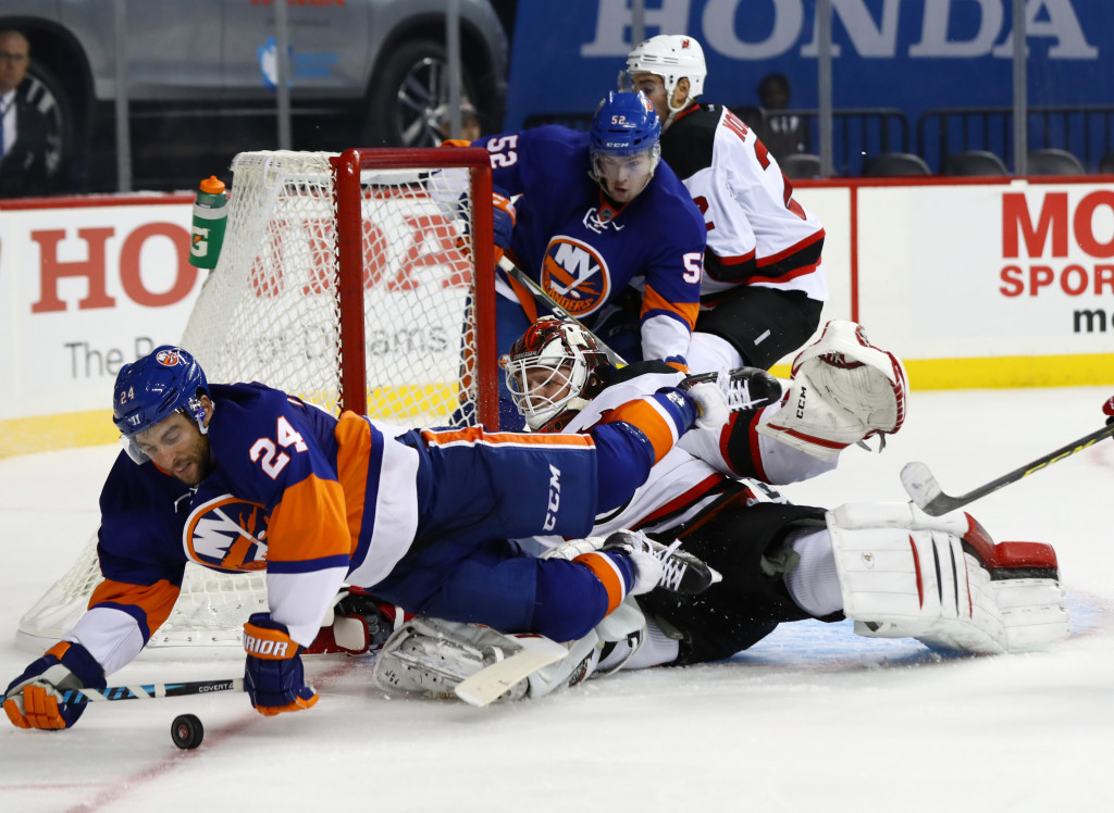 NEW YORK, NY - OCTOBER 03:  Cory Schneider #35 of the New Jersey Devils makes a save against Stephen Gionta #24 of the New York Islanders during their pre season game at Barclays Center on October 3, 2016 in New York City.  (Photo by Al Bello/Getty Images)