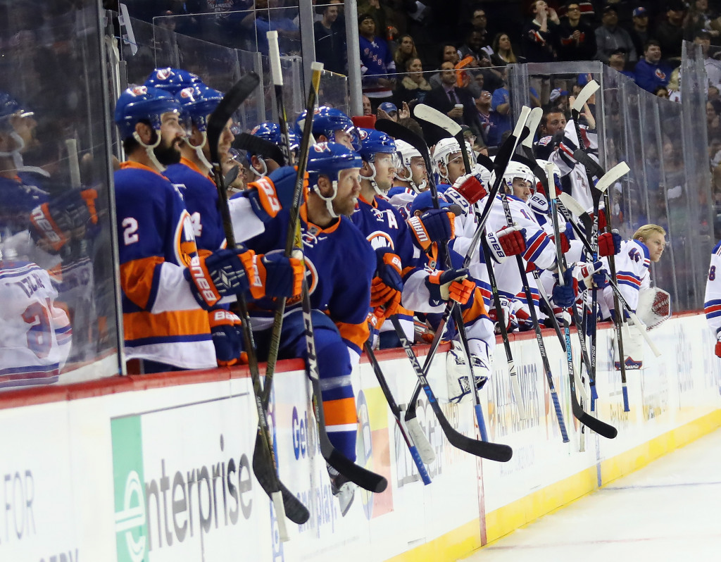 NEW YORK, NY - OCTOBER 04: The New York Islanders and the New York Rangers salute players following a first period fight at the Barclays Center on October 4, 2016 in the Brooklyn borough of New York City.  (Photo by Bruce Bennett/Getty Images)