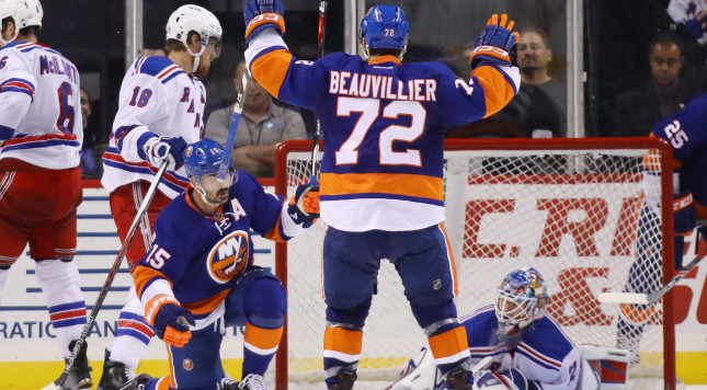 NEW YORK, NY - OCTOBER 04: Cal Clutterbuck #15 of the New York Islanders (l) celebrates his third period goal against Antti Raanta #32 of the New York Rangers at the Barclays Center on October 4, 2016 in the Brooklyn borough of New York City. (Photo by Bruce Bennett/Getty Images)