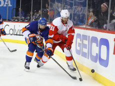 NEW YORK, NY - DECEMBER 04: Nick Leddy #2 of the New York Islanders checks Frans Nielsen #51 of the Detroit Red Wings during the first period at the Barclays Center on December 4, 2016 in the Brooklyn borough of New York City. (Photo by Bruce Bennett/Getty Images)