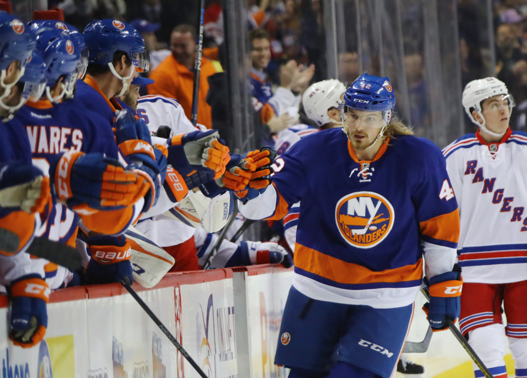 NEW YORK, NY - DECEMBER 06: Scott Mayfield #42 of the New York Islanders celebrates his goal at 7:03 of the first period against the New York Rangers at the Barclays Center on December 6, 2016 in the Brooklyn borough of New York City.</p /> </p><!-- google_ad_section_end --></div>     <div class=