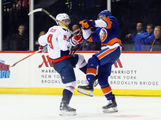 NEW YORK, NY - DECEMBER 13: Dmitry Orlov #9 of the Washington Capitals is stood up by Travis Hamonic #3 of the New York Islanders during the third period at the Barclays Center on December 13, 2016 in the Brooklyn borough of New York City. (Photo by Bruce Bennett/Getty Images)