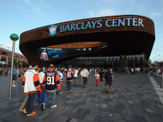 NEW YORK, NY - SEPTEMBER 21:  Fans arrive for a preseason game between the New York Islanders and the New Jersey Devils at the Barclays Center on September 21, 2013 in Brooklyn borough of New York City.The game is the first professional hockey match to be held in the arena that is slated to be the new home for the Islanders at the start of the 2015-2016 season.  (Photo by Bruce Bennett/Getty Images)