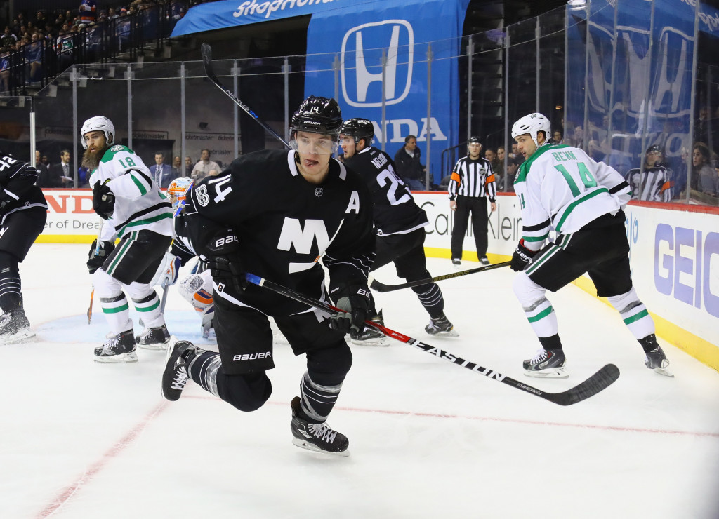 NEW YORK, NY - JANUARY 19: Wearing the 'A' for assistant caption for the first time in the NHL, Thomas Hickey #14 of the New York Islanders skates against the Dallas Stars at the Barclays Center on January 19, 2017 in the Brooklyn borough of New York City.</p /> </p><!-- google_ad_section_end --></div>     <div class=