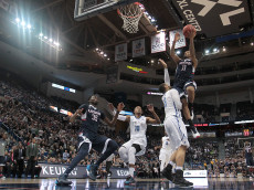HARTFORD, CT - MARCH 14:  Ryan Boatright #11 of the Connecticut Huskies drives to basket against the Tulsa Golden Hurricane in the second half during a semifinal game in the 2015 AAC Championships at the XL Center on March 14, 2015 in Hartford, Connecticut. (Photo by Jim Rogash/Getty Images)