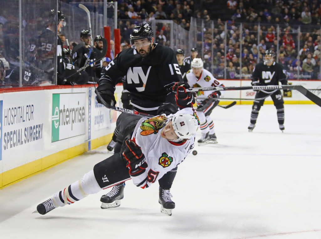 NEW YORK, NY - DECEMBER 15:  Brian Campbell #51 of the Chicago Blackhawks is checked by Cal Clutterbuck #15 of the New York Islanders during the second period at the Barclays Center on December 15, 2016 in the Brooklyn borough of New York City.</p /> </p><!-- google_ad_section_end --></div>     <div class=