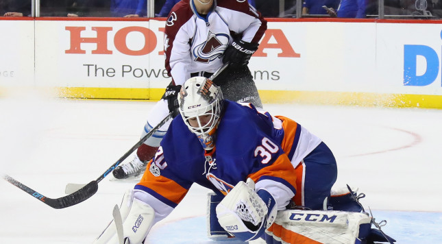 NEW YORK, NY - FEBRUARY 12: Jean-Francois Berube #30 of the New York Islanders makes a first period save on John Mitchell #7 of the Colorado Avalanche (not shown) at the Barclays Center on February 12, 2017 in the Brooklyn borough of New York City.  (Photo by Bruce Bennett/Getty Images)