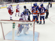 NEW YORK, NY - FEBRUARY 16: The New York Islanders celebrate a third period goal by Nikolay Kulemin #86  against Henrik Lundqvist #30 of the New York Rangers at the Barclays Center on February 16, 2017 in the Brooklyn borough of New York City. The Islanders defeated the Rangers 4-2. (Photo by Bruce Bennett/Getty Images)