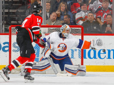 NEWARK, NJ - FEBRUARY 18:  Thomas Greiss #1 of the New York Islanders makes a save in the first period against Adam Henrique #14 of the New Jersey Devils on February 18, 2017 at Prudential Center in Newark, New Jersey.  (Photo by Jim McIsaac/Getty Images)