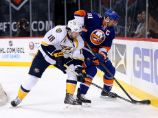 NEW YORK, NY - OCTOBER 15:  John Tavares #91 of the New York Islanders tries to keep the puck from James Neal #18 of the Nashville Predators in the first period at the Barclays Center on October 15, 2015 in the Brooklyn borough of New York City.  (Photo by Elsa/Getty Images)