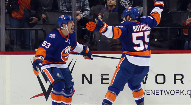 NEW YORK, NY - OCTOBER 23: Casey Cizikas #53 of the New York Islanders celebrates his first period goal against the Boston Bruins along with Johnny Boychuk #55 at the Barclays Center on October 23, 2015 in the Brooklyn borough of New York City.  (Photo by Bruce Bennett/Getty Images)