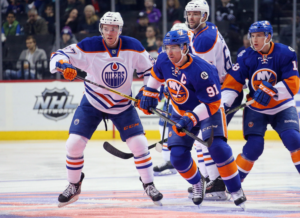 NEW YORK, NY - FEBRUARY 07:  John Tavares #91 of the New York Islanders takes the opening faceoff against Connor McDavid #97 of the Edmonton Oilers at the Barclays Center on February 7, 2016 in the Brooklyn borough of New York City.  (Photo by Bruce Bennett/Getty Images)