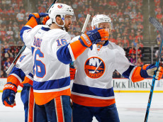 NEWARK, NJ - FEBRUARY 18:  Andrew Ladd #16 of the New York Islanders celebrates his third period goal against the New Jersey Devils with his teammates on February 18, 2017 at Prudential Center in Newark, New Jersey.  (Photo by Jim McIsaac/Getty Images)