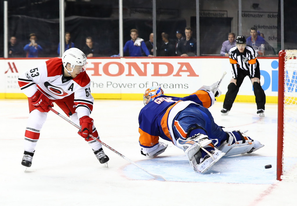 NEW YORK, NY - MARCH 13: Jeff Skinner #53 of the Carolina Hurricanes scores on a penalty shot against Thomas Greiss #1 of the New York Islanders during their game at the Barclays Center on March 13, 2017 in New York City. (Photo by Al Bello/Getty Images)