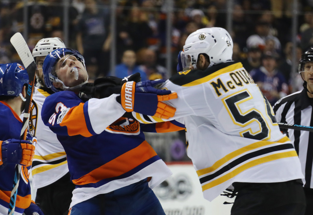 NEW YORK, NY - MARCH 25: Adam McQuaid #54 of the Boston Bruins pushes Casey Cizikas #53 of the New York Islanders during a second period scrum at the Barclays Center on March 25, 2017 in the Brooklyn borough of New York City.</p /> </p><!-- google_ad_section_end --></div>     <div class=