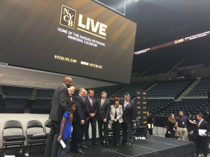 Dignitaries pose for a picture following a press conference to reopen the newly renovated Nassau Coliseum.