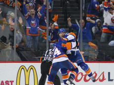 NEW YORK, NY - APRIL 24:  John Tavares #91 of the New York Islanders celebrates his game winning goal at 10:41 of the second overtime against the Florida Panthers and is joined by Thomas Hickey #14 in Game Six of the Eastern Conference First Round during the 2016 NHL Stanley Cup Playoffs at the Barclays Center on April 24, 2016 in the Brooklyn borough of New York City. The Islanders win the series 4 games to 2 to move on to the next round.  (Photo by Bruce Bennett/Getty Images)