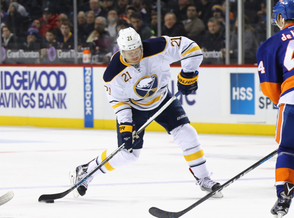 NEW YORK, NY - DECEMBER 23:  Kyle Okposo #21 of the Buffalo Sabres skates against the New York Islanders at the Barclays Center on December 23, 2016 in the Brooklyn borough of New York City. The Islanders defeated the Sabres 5-1.</p /> </p><!-- google_ad_section_end --></div>     <div class=