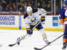 NEW YORK, NY - DECEMBER 23:  Kyle Okposo #21 of the Buffalo Sabres skates against the New York Islanders at the Barclays Center on December 23, 2016 in the Brooklyn borough of New York City. The Islanders defeated the Sabres 5-1.  (Photo by Bruce Bennett/Getty Images)