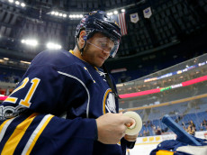 """BUFFALO, NY - MARCH 2: Kyle Okposo #21 of the Buffalo Sabres before the game against the Arizona Coyotes at the KeyBank Center on March 2, 2017 in Buffalo, New York. Sabres beat the Coyotes 6-3. (Photo by Kevin Hoffman/Getty Images) *** Local Caption ***Kyle Okposo""""n""""n"""