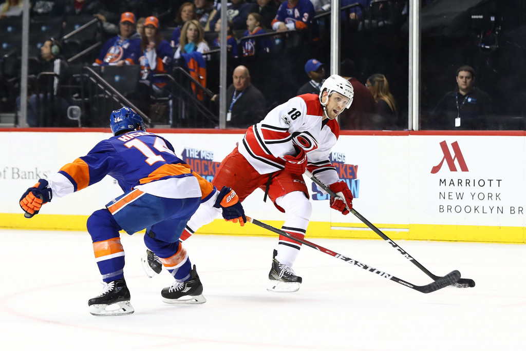 NEW YORK, NY - MARCH 13: Jay McClement #18 of the Carolina Hurricanes skates against Thomas Hickey #14 of the New York Islanders during their game at the Barclays Center on March 13, 2017 in New York City. (Photo by Al Bello/Getty Images)