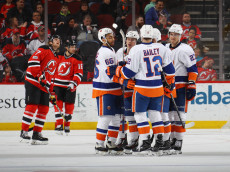 NEWARK, NJ - APRIL 08: The New York Islanders celebrate a goal by Anders Lee #27 (R) at 6:23 of the second period against the New Jersey Devils at the Prudential Center on April 8, 2017 in Newark, New Jersey.  (Photo by Bruce Bennett/Getty Images)