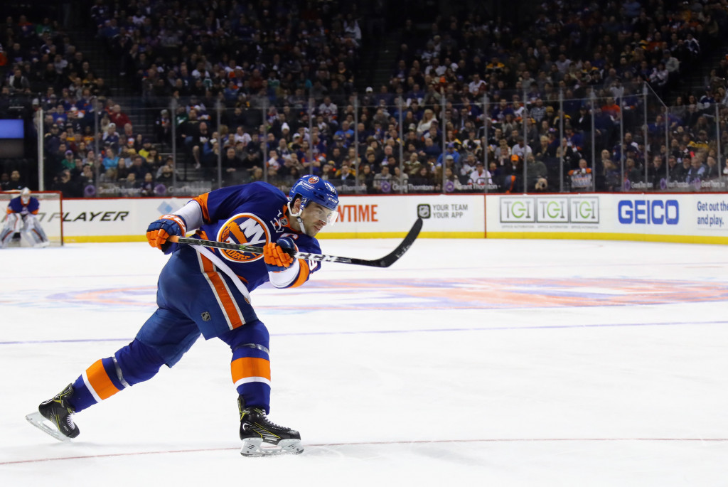 NEW YORK, NY - MARCH 25: John Tavares #91 of the New York Islanders skates against the Boston Bruins at the Barclays Center on March 25, 2017 in the Brooklyn borough of New York City. The Bruins defeated the Islanders 2-1.</p /> </p><!-- google_ad_section_end --></div>     <div class=