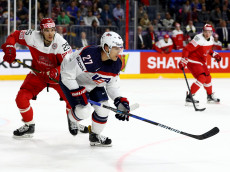 COLOGNE, GERMANY - MAY 07:  Anders Lee #27 of USA challenges Oliver Lauridsen of Denmark for the puck during the 2017 IIHF Ice Hockey World Championship game between USA and Denmark at Lanxess Arena on May 7, 2017 in Cologne, Germany.  (Photo by Martin Rose/Getty Images)