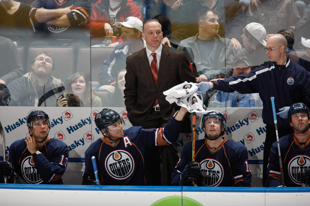EDMONTON, CANADA - MARCH 5: Assistant coach Kelly Buchberger, Shawn Horcoff #10, Robert Nilsson #12 and Andrew Cogliano #12 of the Edmonton Oilers rest on the bench against the Minnesota Wild on March 5, 2010 at Rexall Place in Edmonton, Alberta, Canada. (Photo by Dale MacMillan/Getty Images)