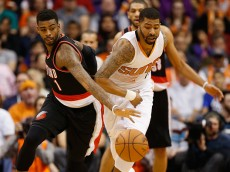 PHOENIX, AZ - JANUARY 21:  Dorell Wright #1 of the Portland Trail Blazers and Marcus Morris #15 of the Phoenix Suns during the NBA game at US Airways Center on January 21, 2015 in Phoenix, Arizona.  The Suns defeated the Trail Blazers 118-113.  NOTE TO USER: User expressly acknowledges and agrees that, by downloading and or using this photograph, User is consenting to the terms and conditions of the Getty Images License Agreement.  (Photo by Christian Petersen/Getty Images)